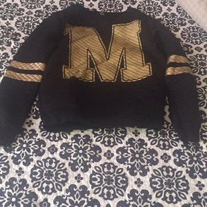 Back and gold sweater